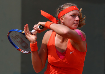 PARIS, FRANCE - MAY 26:  Petra Kvitova of Czech Republic hits a forehand during the women's singles round two match between Jie Zheng of China and Petra Kvitova of Czech Republic on day five of the French Open at Roland Garros on May 26, 2011 in Paris, Fr