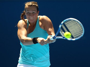 MELBOURNE, AUSTRALIA - JANUARY 22:  Anastasia Pavlyuchenkova of Russia plays a backhand in her third round match against Iveta Benesova of the Czech Republic during day six of the 2011 Australian Open at Melbourne Park on January 22, 2011 in Melbourne, Au