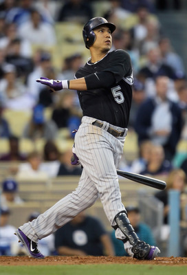 LOS ANGELES, CA - JUNE 01:  Carlos Gonzalez #5 of the Colorado Rockies hits a sacrifice fly in the third inning against the Los Angeles Dodgers at Dodger Stadium on June 1, 2011 in Los Angeles, California. The Rockies defeated the Dodgers 3-0.  (Photo by