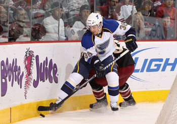 GLENDALE, AZ - MARCH 22:  Matt D'Agostini #36 of the St. Louis Blues skates with the puck during the NHL game against the Phoenix Coyotes at Jobing.com Arena on March 22, 2011 in Glendale, Arizona.  The Coyotes defeated the Blues 2-1.  (Photo by Christian