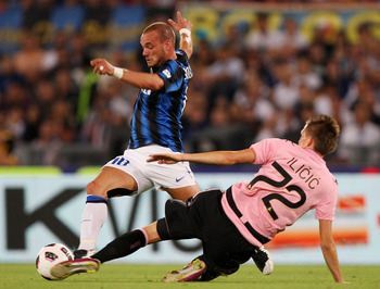 ROME, ITALY - MAY 29:  Wesley Sneider (L)  of FC Internazionale Milano competes for the ball with Josip Ilicic of US Citta di Palermo during the Tim Cup final between FC Internazionale Milano and US Citta di Palermo at Olimpico Stadium on May 29, 2011 in