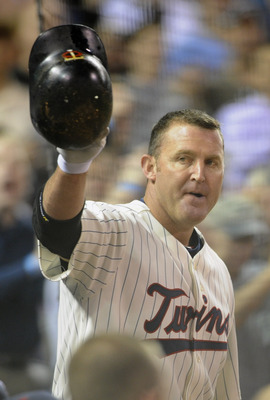 MINNEAPOLIS, MN - MAY 23:  Jim Thome #25 of the Minnesota Twins steps out of the dugout for a curtain call following his second home run against the Seattle Mariners in the seventh inning of their game on May 16, 2011 at Target Field in Minneapolis, Minne