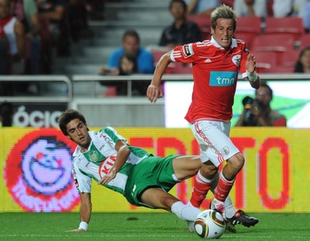 LISBON, PORTUGAL - AUGUST 28:  Fabio Coentrao (R) of Benfica tackles Paulo Regula (L) of Vitoria Setubal during the Portuguese Liga match between Benfica and Vitoria Setubal at Luz Stadium on August 28, 2010 in Lisbon, Portugal.  (Photo by Patricia de Mel