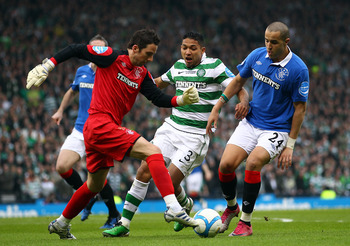GLASGOW, SCOTLAND - MARCH 20:  Goalkeeper, Neil Alexander of Rangers in action with Emilio Izaguirre of Celtic and Madjid Bougherra of Rangers during the Co-operative Insurance Cup final between Celtic and Rangers at Hampden Park on March 20, 2011 in Glas