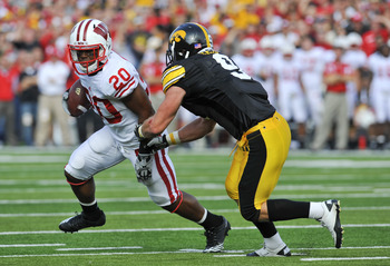IOWA CITY, IA - OCTOBER 23: Defensive back Tyler Sash #9 of the University of Iowa Hawkeyes closes in on running back James White #20 of the Wisconsin Badgers as he rushes for yards during the first half of play at Kinnick Stadium on October 23, 2010 in I