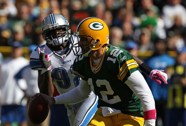 GREEN BAY, WI - OCTOBER 03: Aaron Rodgers #12 of the Green Bay Packers moves to avoid Cliff Avril #92 of the Detroit Lions at Lambeau Field on October 3, 2010 in Green Bay, Wisconsin. (Photo by Jonathan Daniel/Getty Images)