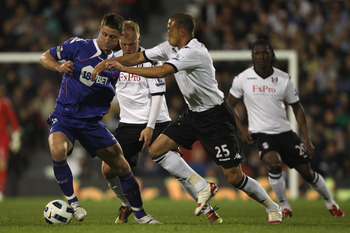 LONDON, ENGLAND - APRIL 27: Gary Cahill (L) of Bolton holds off Bobby Zamora (R) during the Barclays Premier League match between Fulham and Bolton Wanderers at Craven Cottage on April 27, 2011 in London, England.  (Photo by Michael Steele/Getty Images)