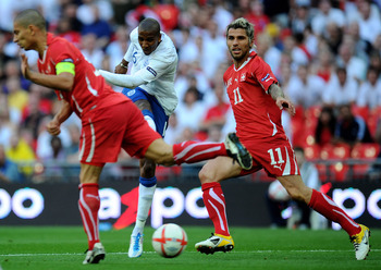 LONDON, ENGLAND - JUNE 04:  Ashley Young (C) of England shoots and scores their second equalising goal during the UEFA EURO 2012 group G qualifying match between England and Switzerland at Wembley Stadium on June 4, 2011 in London, England.  (Photo by Cli