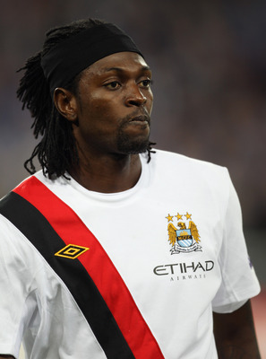 POZNAN, POLAND - NOVEMBER 04:  Emmanuel Adebayor of Manchester City looks on during the UEFA Europa League Group A match between KKS Lech Poznan and Manchester City at the Bulgarska Street Stadium on November 4, 2010 in Poznan, Poland.  (Photo by Bryn Len