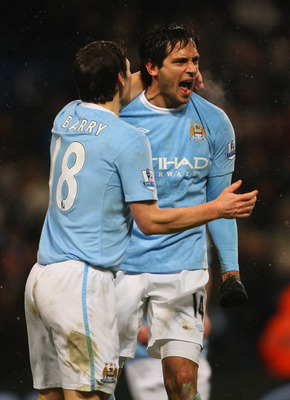 MANCHESTER, ENGLAND - DECEMBER 19:  Manchester City goalscorer Roque Santa Cruz (R) celebrates the winning goal with Gareth Barry during the Barclays Premier League game between Manchester City and Sunderland at City of Manchester Stadium on December 19,