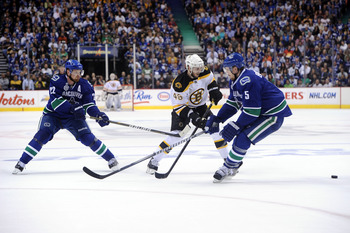 VANCOUVER, BC - JUNE 01: Daniel Sedin #22 and Christian Ehrhoff #5 of the Vancouver Canucks skates against the Boston Bruins during game one of the 2011 NHL Stanley Cup Finals at Rogers Arena on June 1, 2011 in Vancouver, Canada.  (Photo by Harry How/Gett