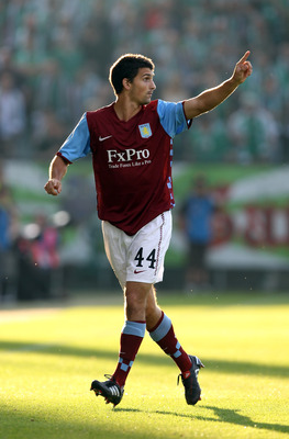 VIENNA, AUSTRIA - AUGUST 19:  Eric Lichaj of Aston Villa gestures during the UEFA Europa League, Play off, first leg Qualifying match between Rapid Vienna and Aston Villa at the Gerhard Hanappi Stadium on August 19, 2010 in Vienna, Austria.  (Photo by Ian
