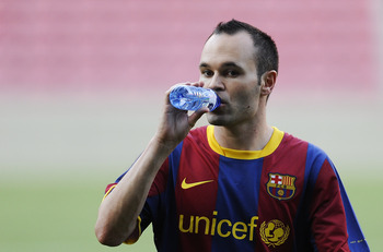 BARCELONA, SPAIN - MAY 23:  Andres Iniesta of FC Barcelona sips a drink during the FC Barcelona training session held ahead of next saturday UEFA Champions League Final at the Camp Nou Stadium on May 23, 2011 in Barcelona, Spain.  (Photo by David Ramos/Ge