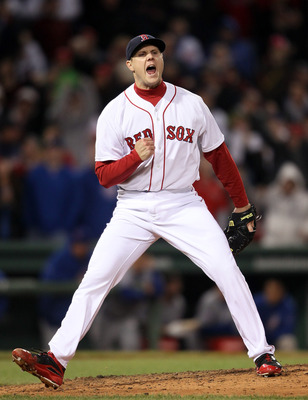 BOSTON, MA - MAY 22: Jonathan Papelbon #58 of the Boston Red Sox celebrates the win over the Chicago Cubs on May 22, 2011 at Fenway Park in Boston, Massachusetts.  Before this series, the two teams haven't played at Fenway Park since the 1918 World Series