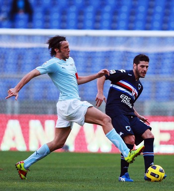 ROME, ITALY - JANUARY 16:  Stefano Mauri of SS Lazio competes for the ball with Pietro Accardi (R) of UC Sampdoria during the Serie A match between SS Lazio and UC Sampdoria at Stadio Olimpico on January 16, 2011 in Rome, Italy.  (Photo by Paolo Bruno/Get