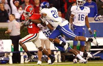 ATHENS, GA - NOVEMBER 21:  Tavarres King #12 of the Georgia Bulldogs is tackled by Trevard Lindley #32 and Winston Guy Jr. #21 of the Kentucky Wildcats at Sanford Stadium on November 21, 2009 in Athens, Georgia.  (Photo by Kevin C. Cox/Getty Images)