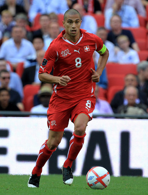 LONDON, ENGLAND - JUNE 04:  Gokhan Inler of Switzerland in action during the UEFA EURO 2012 group G qualifying match between England and Switzerland at Wembley Stadium on June 4, 2011 in London, England.  (Photo by David Cannon/Getty Images)
