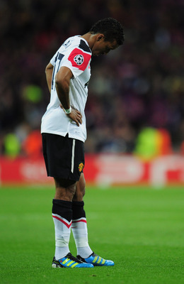 LONDON, ENGLAND - MAY 28:  Luis Nani of Manchester United looks dejected after defeat during the UEFA Champions League final between FC Barcelona and Manchester United FC at Wembley Stadium on May 28, 2011 in London, England.  (Photo by Shaun Botterill/Ge