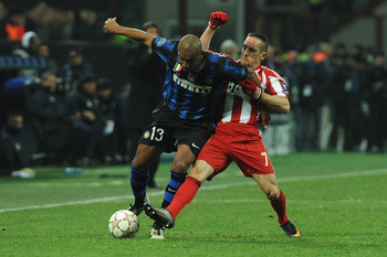 MILAN, ITALY - FEBRUARY 23:  Douglas Maicon of Inter Milan is challenged by Franck Ribery of FC Bayern Muenchen during the UEFA Champions League round of 16 first leg match between Inter Milan v FC Bayern Muenchen on February 23, 2011 in Milan, Italy.  (P