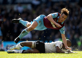 LONDON, ENGLAND - MARCH 19:  Scott Parker (up) of West Ham tangles with Jermain Defoe of Tottenham during the Barclays Premier League match between Tottenham Hotspur and West Ham United at White Hart Lane on March 19, 2011 in London, England.  (Photo by I