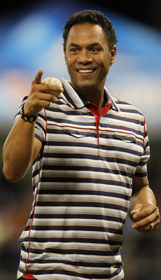 SAN JUAN, PUERTO RICO - JUNE 30:  Roberto Alomar Jr. throws out the first pitch before the game between the New York Mets and the Florida Marlins  during their game at Hiram Bithorn Stadium on June 30, 2010 in San Juan, Puerto Rico.  (Photo by Al Bello/Ge