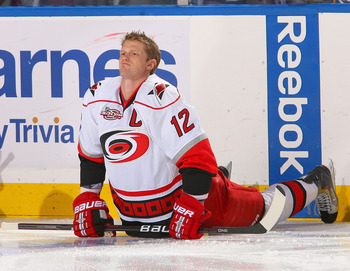BUFFALO, NY - MARCH 15: Eric Staal #12 of the Carolina Hurricanes streches during warm ups prior to play against the Buffalo Sabres at HSBC Arena on March 15, 2011 in Buffalo, New York. Carolina won 1-0.  (Photo by Rick Stewart/Getty Images)