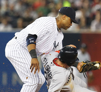 NEW YORK, NY - JUNE 07:  Robinson Cano #24 of the New York Yankees tags out Jacoby Ellsbury #2 of the Boston Red Sox on a steal attempt during their game on June 7, 2011 at Yankee Stadium in the Bronx borough of New York City.  (Photo by Al Bello/Getty Im
