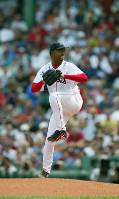 BOSTON, MA - AUGUST 30:  Pedro Martinez #45 of the Boston Red Sox winds up for the pitch during the game against the New York Yankees at Fenway Park on August 30, 2003  in Boston, Massachusetts. The Yankees won 10-7.  (Photo by Rick Stewart/Getty Images)