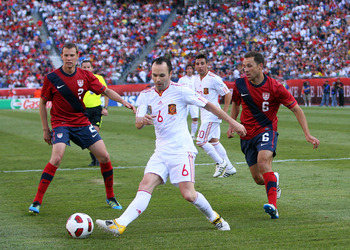 FOXBORO, MA - JUNE 4:  Andres Iniesta #6 of Spain keeps the ball from Jonathan Spector #2 of the United States and Steve Cherundolo #6 of the United States at Gillette Stadium on June 4, 2011 in Foxboro, Massachusetts. Spain beat the United States 4-0. (P