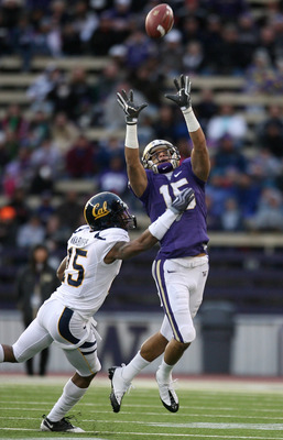 SEATTLE - DECEMBER 05:  Wide receiver Jermaine Kearse #15 of the Washington Huskies makes a leaping catch against Bryant Nnabuife #15 of the California Bears on December 5, 2009 at Husky Stadium in Seattle, Washington. The Huskies defeated the Bears 42-10