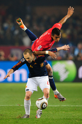 PRETORIA, SOUTH AFRICA - JUNE 25: Arturo Vidal of Chile challenges Andres Iniesta of Spain during the 2010 FIFA World Cup South Africa Group H match between Chile and Spain at Loftus Versfeld Stadium on June 25, 2010 in Tshwane/Pretoria, South Africa.  (P