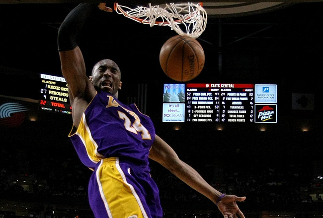 PORTLAND, OR - APRIL 08:  Kobe Bryant #24 of the Los Angeles Lakers dunks the ball over Jarrett Jack #1 the Portland Trail Blazers at the Rose Garden on April 8, 2008 in Portland, Oregon.  NOTE TO USER: User expressly acknowledges and agrees that, by down