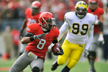 COLUMBUS, OH - NOVEMBER 27:  DeVier Posey #8 of the Ohio State Buckeyes heads for the endzone on a 33-yard touchdown reception in the second quarter as Adam Patterson #99 of the Michigan Wolverines pursues at Ohio Stadium on November 27, 2010 in Columbus,