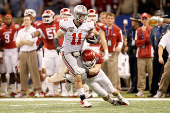 NEW ORLEANS, LA - JANUARY 04:  Jake Stoneburner #11 of the Ohio State Buckeyes runs after a catch against the Arkansas Razorbacks in the first quarter in the Allstate Sugar Bowl at the Louisiana Superdome on January 4, 2011 in New Orleans, Louisiana.  (Ph