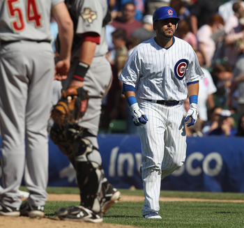 CHICAGO, IL - JUNE 01:  Geovany Soto #18 of the Chicago Cubs walks back to the dugout after making the final out against the Houston Astros at Wrigley Field on June 1, 2011 in Chicago, Illinois. The Astros defeated the Cubs 3-1.  (Photo by Jonathan Daniel