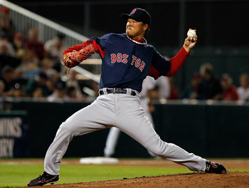 FORT MYERS, FL - FEBRUARY 27:  Pitcher Hideki Okajima #37 of the Boston Red Sox pitches against the Minnesota Twins during a Grapefruit League Spring Training Game at Hammond Stadium on February 27, 2011 in Fort Myers, Florida.  (Photo by J. Meric/Getty I