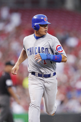 CINCINNATI, OH - JUNE 6: Kosuke Fukudome #1 of the Chicago Cubs scores a run on a sacrifice fly in the fifth inning against the Cincinnati Reds at Great American Ball Park on June 6, 2011 in Cincinnati, Ohio. (Photo by Joe Robbins/Getty Images)