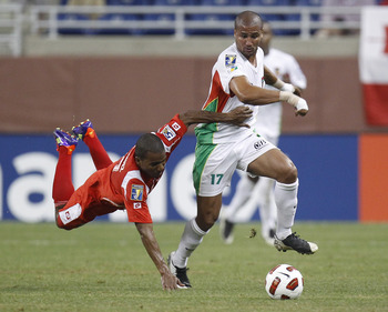 DETROIT, MI - JUNE 7: Cedric Collet #17 of Guadeloupe drives past the diving Luis Henriquez #17 of Panama during the 2011 Gold Cup  at Ford Field on June 7, 2011 in Detroit, Michigan. Panama won the game 3-2. (Photo by Gregory Shamus/Getty Images)