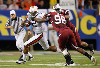 ATLANTA, GA - DECEMBER 04:  Devin Taylor #98 and Cliff Matthews #83 of the South Carolina Gamecocks force a fumble by quarterback Cam Newton #2 of the Auburn Tigers during the 2010 SEC Championship at Georgia Dome on December 4, 2010 in Atlanta, Georgia.