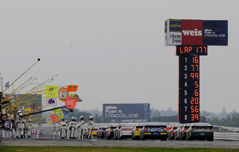 LONG POND, PA - AUGUST 01:  The field prepares to leave pit road after a red flag delay during the NASCAR Sprint Cup Series Sunoco Red Cross Pennsylvania 500 at Pocono Raceway on August 1, 2010 in Long Pond, Pennsylvania.  (Photo by Rusty Jarrett/Getty Im