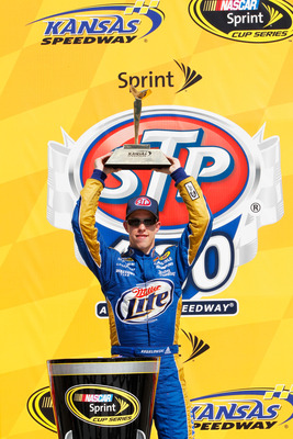 KANSAS CITY, KS - JUNE 05:  Brad Keselowski, driver of the #2 Miller Lite Dodge, celebrates in Victory Lane after winning the NASCAR Sprint Cup Series STP 400 at Kansas Speedway on June 5, 2011 in Kansas City, Kansas.  (Photo by Geoff Burke/Getty Images f