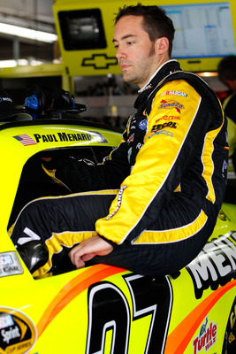 CHARLOTTE, NC - MAY 28: Paul Menard, driver of the #27 Moen/Menards Chevrolet, climbs into his car prior to practice for the NASCAR Sprint Cup Series Coca-Cola 600 at Charlotte Motor Speedway on May 28, 2011 in Charlotte, North Carolina.  (Photo by Geoff