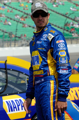 KANSAS CITY, KS - JUNE 04:  Martin Truex Jr., driver of the #56 NAPA Auto Parts Toyota, stands on the grid during qualifying for the NASCAR Sprint Cup Series STP 400 at Kansas Speedway on June 4, 2011 in Kansas City, Kansas.  (Photo by John Harrelson/Gett