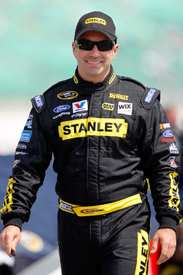 KANSAS CITY, KS - JUNE 04:  Marcos Ambrose, driver of the #9 Stanley Ford, stands on the grid during qualifying for the NASCAR Sprint Cup Series STP 400 at Kansas Speedway on June 4, 2011 in Kansas City, Kansas.  (Photo by Todd Warshaw/Getty Images)
