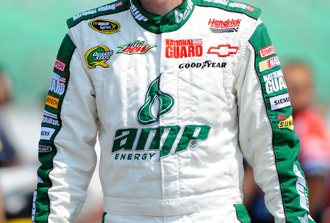 KANSAS CITY, KS - JUNE 04:  Dale Earnhardt Jr., driver of the #88 Amp Energy/National Guard Chevrolet, stands on the grid during qualifying for the NASCAR Sprint Cup Series STP 400 at Kansas Speedway on June 4, 2011 in Kansas City, Kansas.  (Photo by Jare