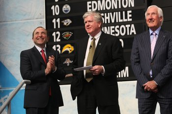 MONTREAL - JUNE 26:  NHL Commissioner Gary Bettman, Toronto Maple Leafs President & GM Brian Burke and Special Advisor Cliff Fletcher look on during the first round of the 2009 NHL Entry Draft at the Bell Centre on June 26, 2009 in Montreal, Quebec, Canad