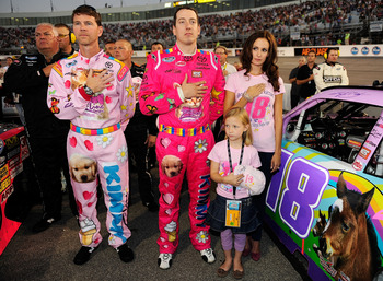 RICHMOND, VA - SEPTEMBER 10:  Kyle Busch (C), driver of the #18 Toyota Kimmy/Z-Line Designs Toyota, his girlfriend Samantha Sarcinella (R) crew chief Jason Ratcliff (L) and contest winner Lennon Wynn (Bottom) stand on the grid prior to the NASCAR Nationwi