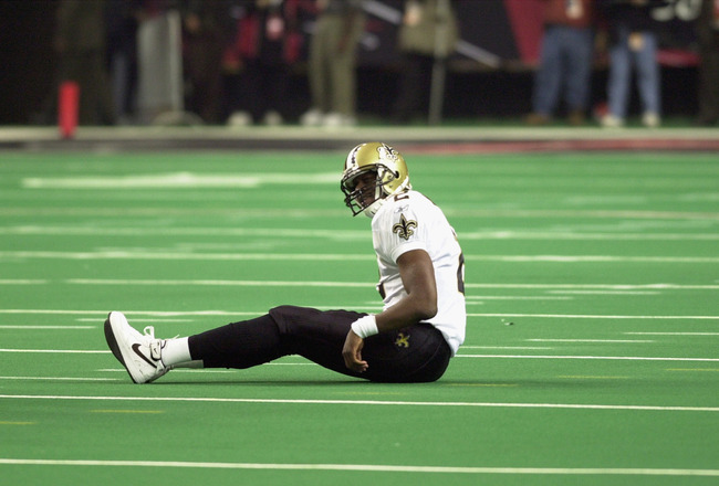 ATLANTA - NOVEMBER 17:  Aaron Brooks #2 of the New Orleans Saints sits on the turf after a play during the NFL game against the Atlanta Falcons at the Georgia Dome on November 17, 2002 in Atlanta, Georgia. The Falcons defeated the Saints 24-17. (Photo by