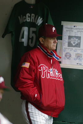 PHILADELPHIA - APRIL 4:  Manager Larry Bowa of the Philadelphia Phillies stands next to the jersey of former player Tug McGraw during the game against the Pittsburgh Pirates at Veterans Stadium on April 4, 2003 in Philadelphia, Pennsylvania.  McGraw had s