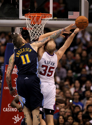 LOS ANGELES, CA - MARCH 5:   Chris Andersen #11 of the Denver Nuggets blocks a shot attempt by Chris Kaman #35 of the Los Angeles Clippers at Staples Center on March 5, 2011 in Los Angeles, California. The Clippers won 100-94. NOTE TO USER: User expressly